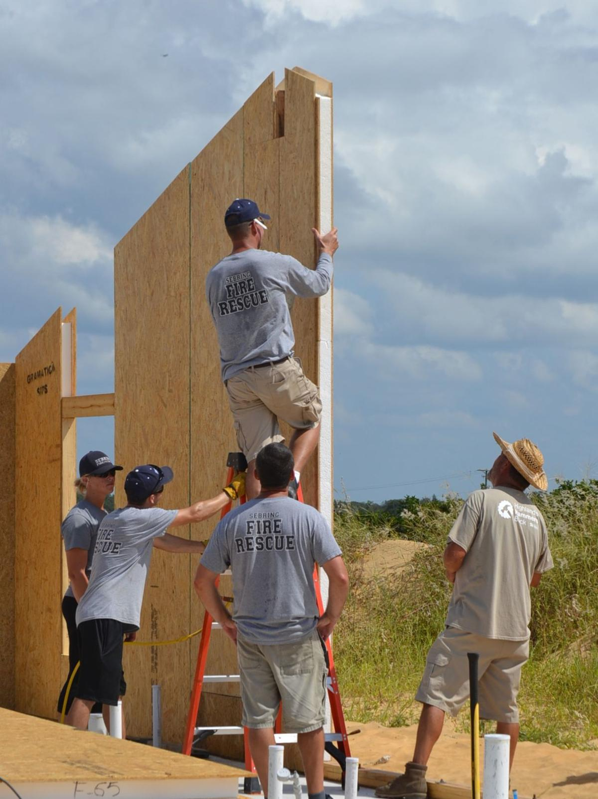 Securing wall panels