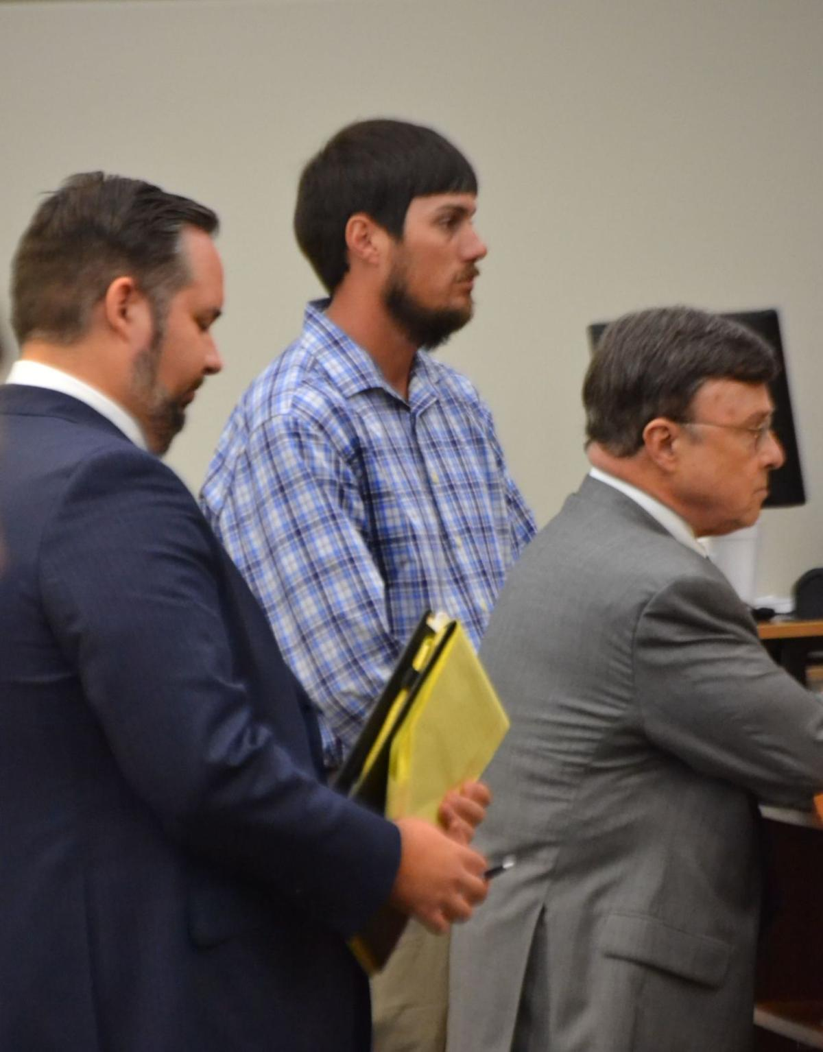 Zachary Lehman with his attorneys