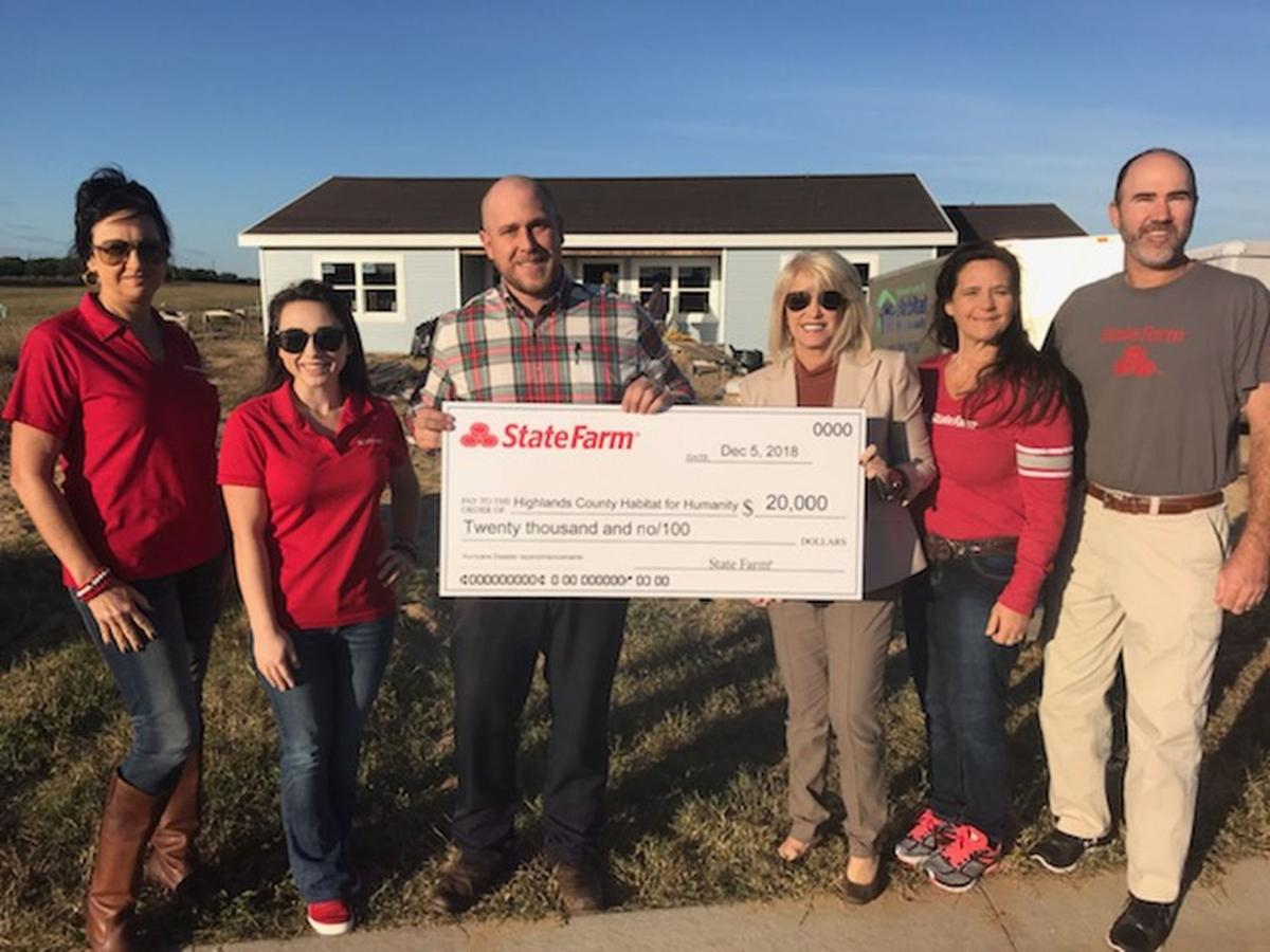 Donation of the check from State Farm