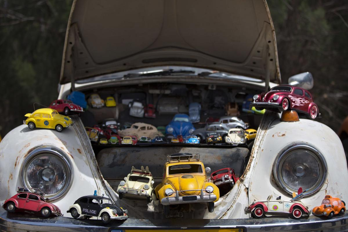 Car toys seen on Volkswagon Beetle display