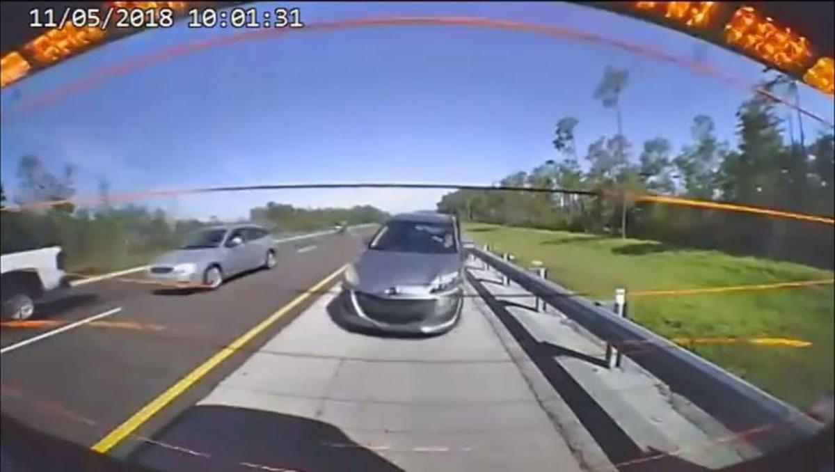 Car swerves onto shoulder