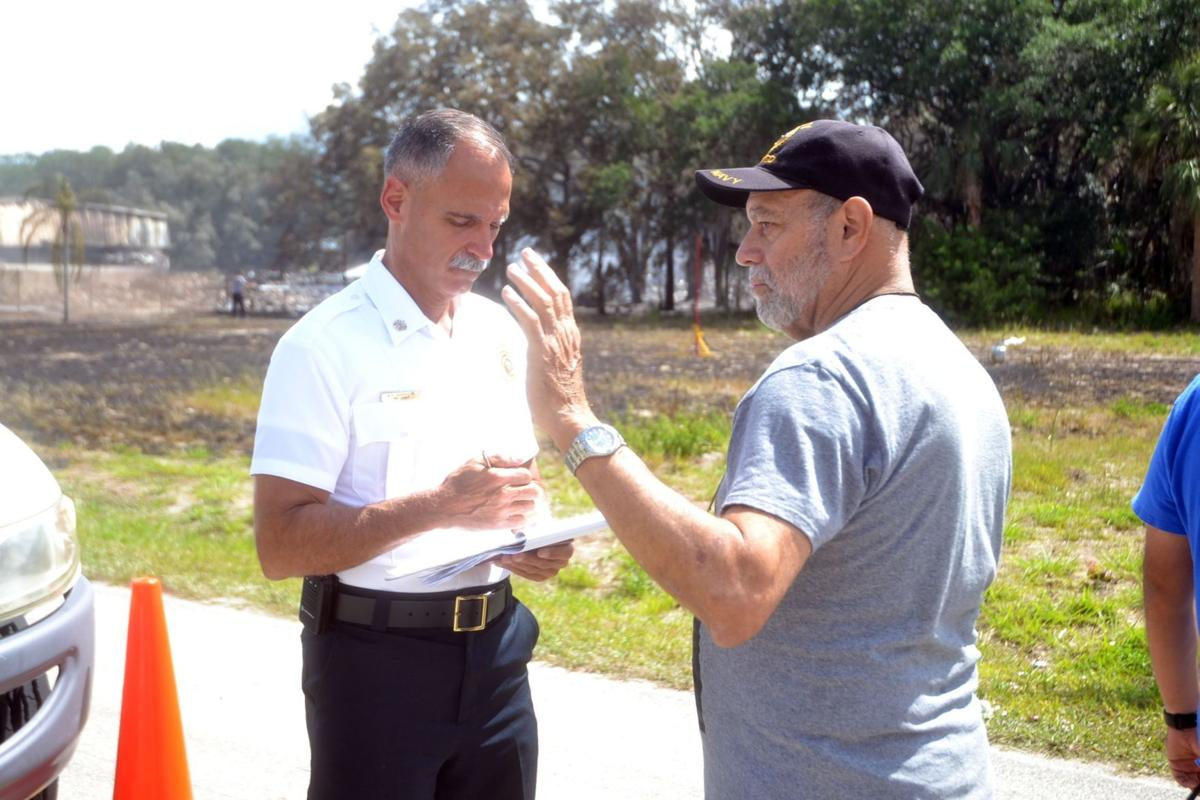 Candido Garcia talks with HCFR Chief Marc Bashoor