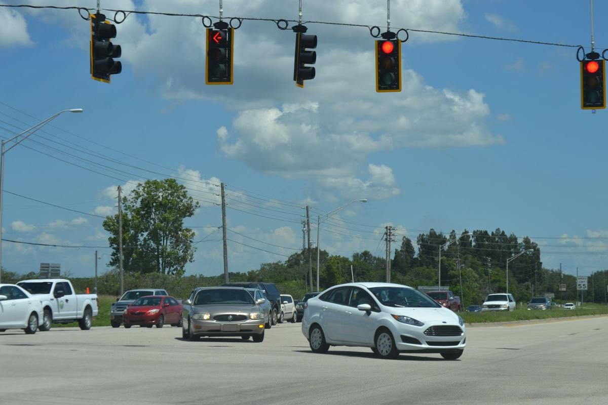 Traffic turning left onto U.S. 98