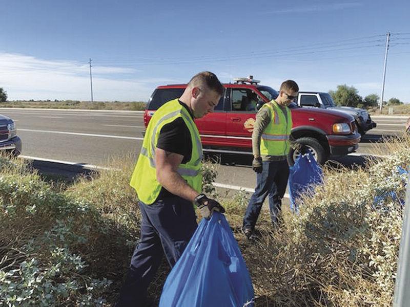 Volunteers clean up along Firefighter David Irr Memorial Freeway