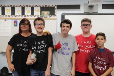 Kindness T-shirts help bring Woodard community together